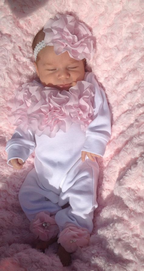 Super soft adorable little romper set for your little baby.. Chiffon is on the chest and small flowers on bottom of the pants.. Bottom has snaps for easy dressing. Comes with matching headband with small rhinestone..so so cute!!! Please note: second photo is just to show how it
