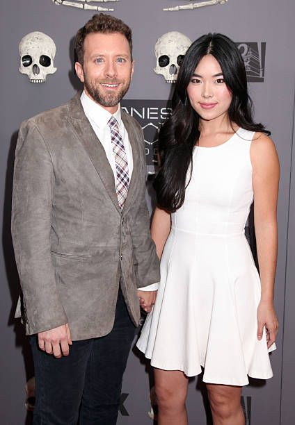 Actor T J  Thyne and Leah Park arriving at Bones 200th