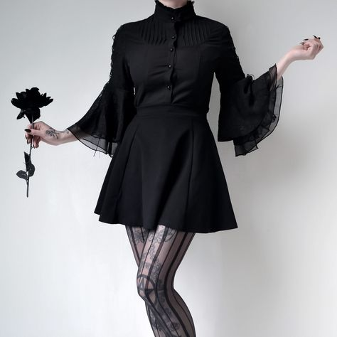 Women's Gothic Pagoda Cropped Sleeves Jacquard Shirt  $48.3                Model: Kibbi          A very basic black shirt has the ability to be worn forever, paired with a skirts or shorts or pants and in style for years to come.