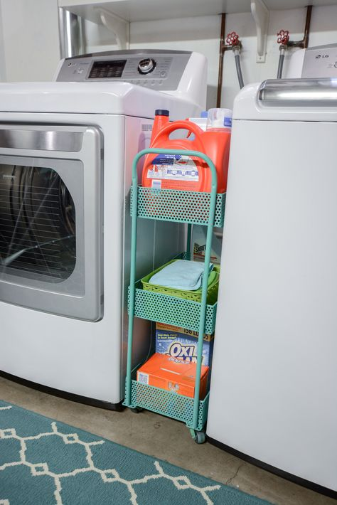 Organized laundry and cleaning supplies. This aqua cart is perfect for storing items between the washer and dryer. #TuesdayMorning #ad