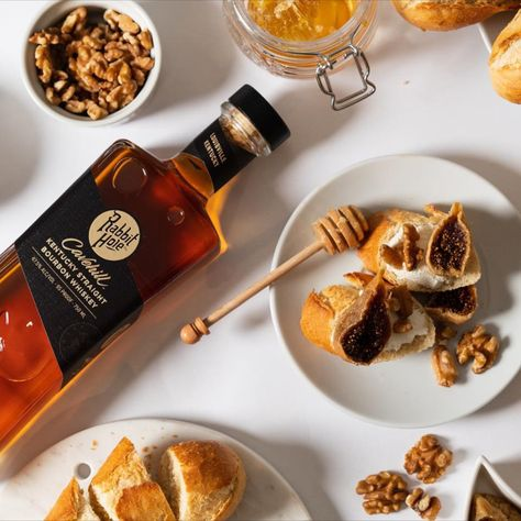 Coupled with the sweet taste of honey and freshly ripe figs, Cavehill celebrates life at its best. Straightforward, unfussy and sincere, this pairing features whipped cream cheese on toasted bread, topped with figs, honey, and walnuts. This simple and elegant combination is an irresistible companion to the balanced palate of our original 4 grain straight bourbon whiskey. Head over to our website & click the James Beard Foundation link for pairings with each of our spirits. #pairings #bourbon