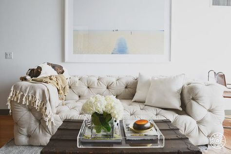 Casey's Apartment - Casey and Tuck's favorite piece of furniture is this outrageously comfortable couch. by Homepolish New York City https://www.homepolish.com/mag/caseys-apartment