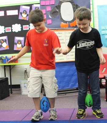 More Penguin Fun!  We had penguin relays to see who could finish the race first. We found out that it is very difficult to keep the egg from falling when you are trying to walk.