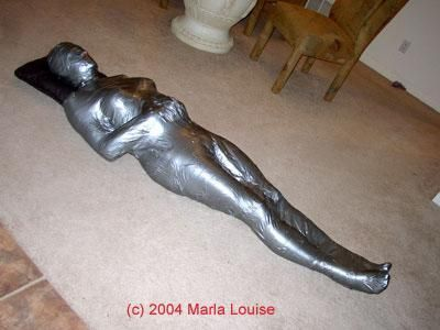 female mummification bondage