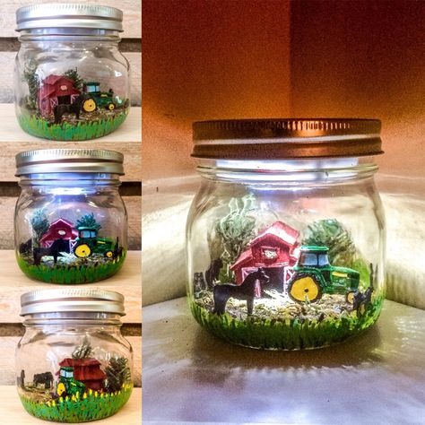 A homage to the heartland...This Farm theme Mason jar LED Night Light has a green John Deere inspired tractor, solid plastic red barn, moss and faux pine trees, a brown and green moss