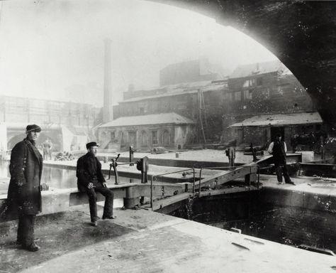 "Caption: ""Entrance to Regent's Canal Dock under Commercial Road"""