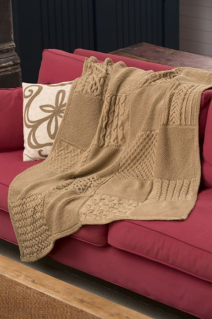 Ten bias garter-stitch squares and 10 different cabled squares make up this checkerboard-style afghan. Each square is knit separately, then the pieces are sewn together and a border is picked up and knit.