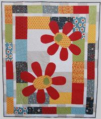 Aint She Sweet Quilt Pattern by Abbey Lane Quilts at KayeWood.com is just way too fun.  Two large funky flowers have a great tone on tone background.  They are then surrounded with bright fun fabrics. A quick, easy quilt. http://www.kayewood.com/item/Ain_t_She_Sweet_Quilt_Pattern/2989 $10.00