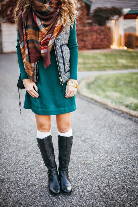 rain boots, scarf, vest, and dress