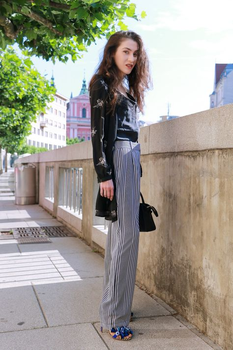 596c874eaf39 Fashion blogger Veronika Lipar of Brunette From Wall Street sharing how to  do layering this summer wearing dark floral shirt dress and wide-leg  trousers