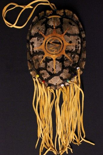 Large Turtle Shell Medicine Pouch with Sun design painted in gold with red beads on the back. R.Neganigwane (Pheasant); artwork J.Jacko. Visit our site for more Medicine Pouches www.kitigan.com