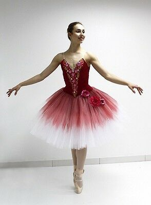The bodice is made of the semi-stretch fabric. Bodice is decorated hand-made with floral appliques, crystals, sequins and rhinestones. Actual fabric colors may differ slightly from models pictured on-line.