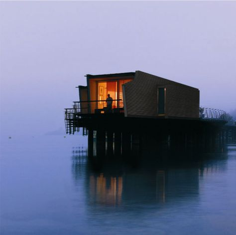 Hôtel Palafitte  A series of small apartments on stilts, adrift in the middle of Neuchâtel Lake in Switzerland...