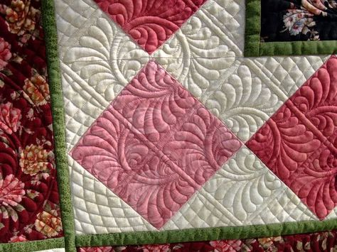 I like the way the quilted blocks don't follow the pieced blocks Raylene Smith