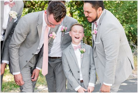 Groom and groomsmen laugh in gray suits with blush ties | Oak Hills Utah Dusty Rose and Gray Summer Wedding | Jessie and Dallin Photography #utahwedding #utahsummerwedding #summerwedding #mountainwedding #rockymountainwedding #blushandgraywedding #blushandgray #oakhillsutah #utahweddingvenue