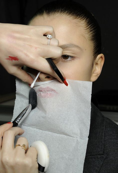 Matte and/or make your lipstick stay.  Learned this trick from one of the other makeup artist at Estee Lauder when I worked there. Apply lipstick/liner normally, place single ply of a cheap tissue over your lip, dip a powder brush into some translucent loose face powder and brush it lightly over tissue over lips.