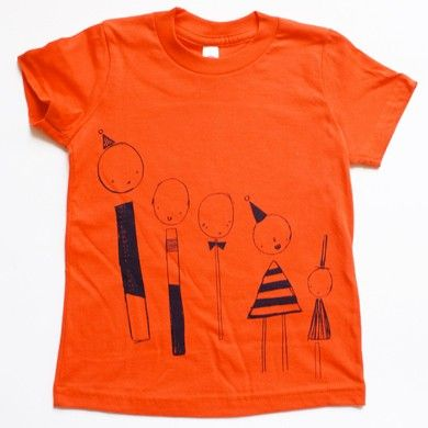 Short sleeve orange t-shirt with Line-up print by Corby Tindersticks * The Pippa & Ike Show