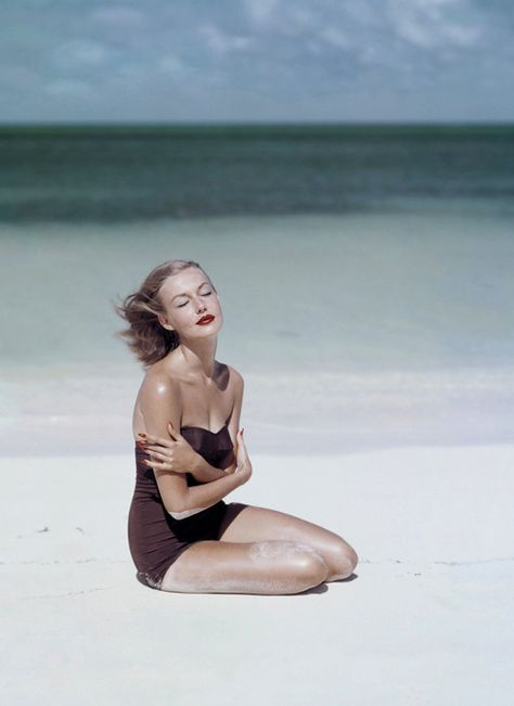 1950s Vogue. Photography by John Rawlings. I'm all for any era that embraces red lips on the beach