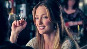 Minka Kelly smoking a cigarette (or weed)