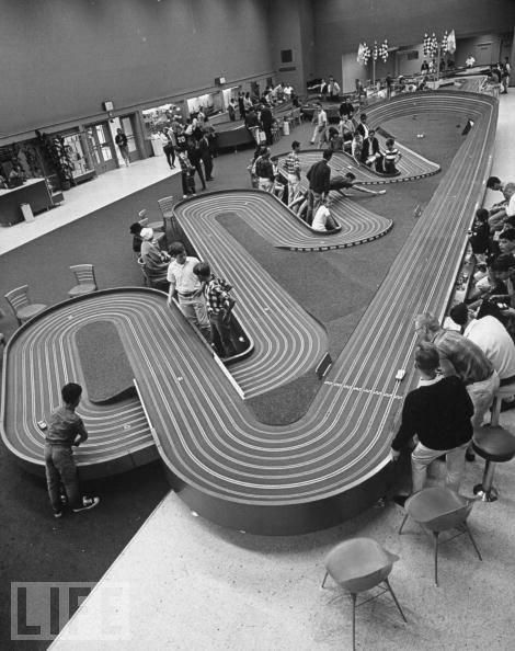 In the 60's slot car Racing was so much fun.This is Play Land at the Beach. Kids had their own car/s, Dad's would usually help work on them with their kids and every weekend the Race was on. The cars would race around the track. the tracks had slots in them and the cars had a little mechanism on the bottom that once fit into the electrical slot in the track, the car would take off powered by little hand controls the kids would operate. Trophy's/awards were earned for winning heats  races