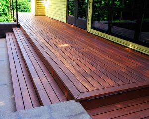 This Beautiful Deck Was Built With State Of The Art Timbertech Low Maintenance Tigerwood Decking A Mocha Border Boards Vary In