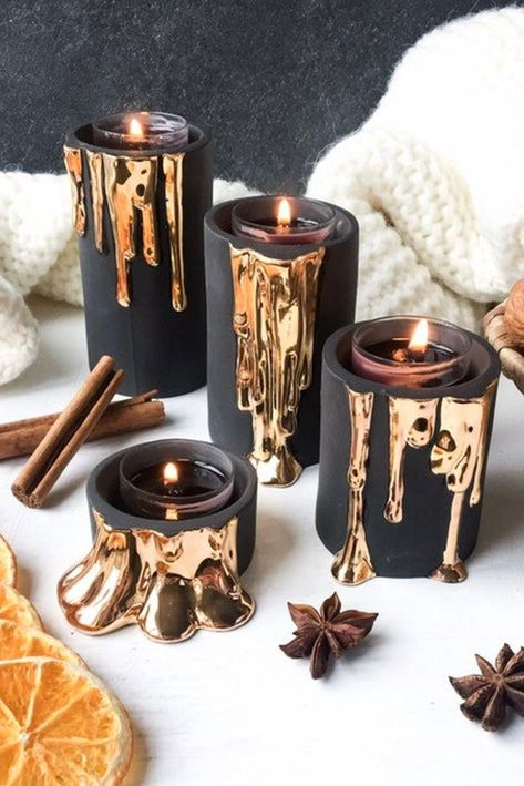 Adding a dose of luxe-spookiness to your candle collection this season with these black and gold candle holders, perfect for Halloween or fall.