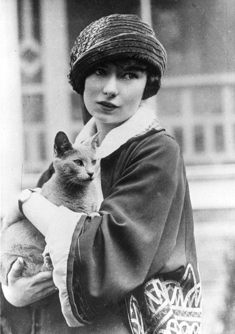 """""""Gone with the Wind"""" author and journalist Margaret Mitchell (1900-1949) with a beautiful #cat. Courtesy of Atlanta History Center"""
