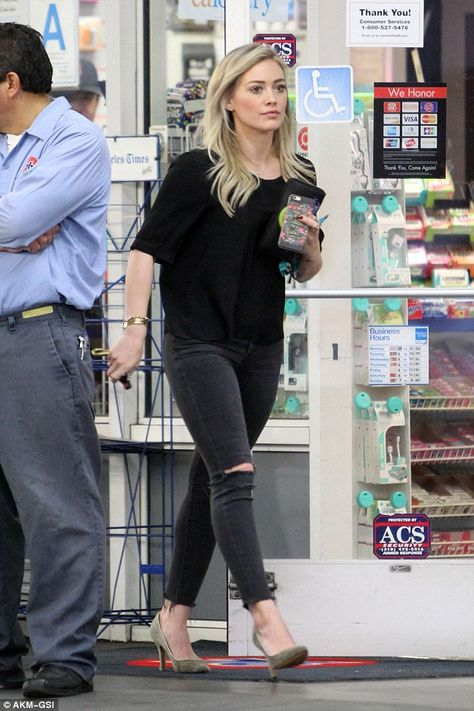 Hilary Duff highlights her legs in ripped skinny jeans and suede heels