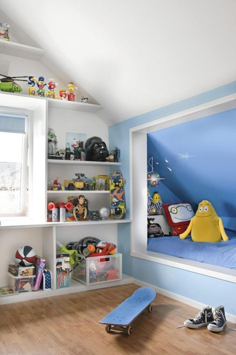 built-in sleeping nook and wonderful shelving in this kid's bedroom. Great use of space.