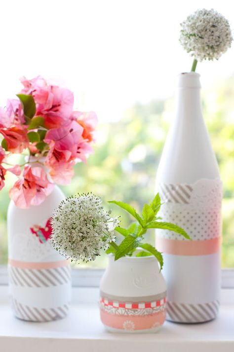 Dressing up white spray painted glass bottles with a little washi tape and a couple paper doilies