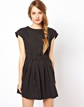 Pretty dotted dress and an awesome side braid.
