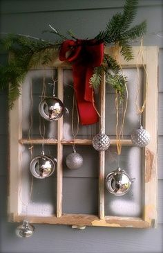 Christmas window idea with window pane, red bow, silver ornaments. I think this would be a great front door wreath for a house in the desert!!! Especially with Juniper for the greenery, and a red print bandana for the bow!!   best stuff