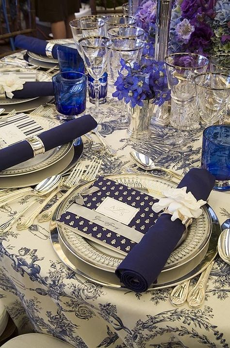 I like the idea of color on white table linens, with a different pattern menu and a solid napkin. OP: Navy blue toile tablecloths are accented with navy blue napkins and one of two menu patterns.