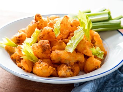 A vegan game-day snack made with ultra-crisp battered cauliflower tossed in garlicky buffalo sauce.