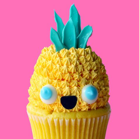 Don't worry, this cupcake WANTS you to eat him. Just look at that smile!