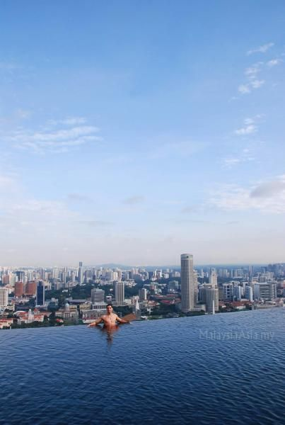 This amazing picture was taken on top of the marina bay sands resort hotel in singapore and features the much talked about infinity swimming pool at the sky