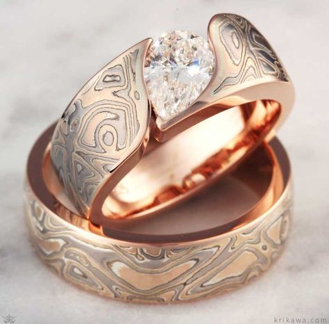Mokume Wave ring set with pear cut diamond and high-polished Champagne Mokume Gane. Customize your ring in the metal, mokume and stones you want!