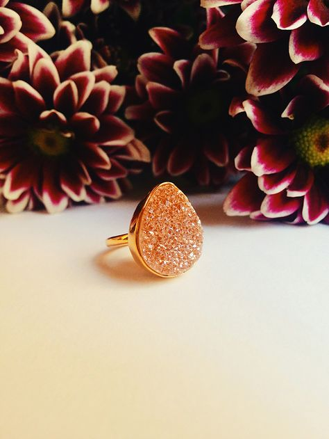 Dress up an outfit with this lovely genuine rose pink drusy quartz peardrop ring.