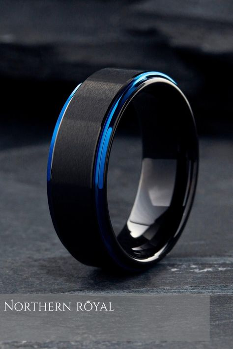 Men's modern black and blue wedding ring. This ring features a black matte textured top with polished blue step-down edges. The polished interior is comfortable and smooth. He will never want to take this ring off. So many other blue and black wedding rings to pick from. #mensweddingrings #bluerings #mensweddingband.