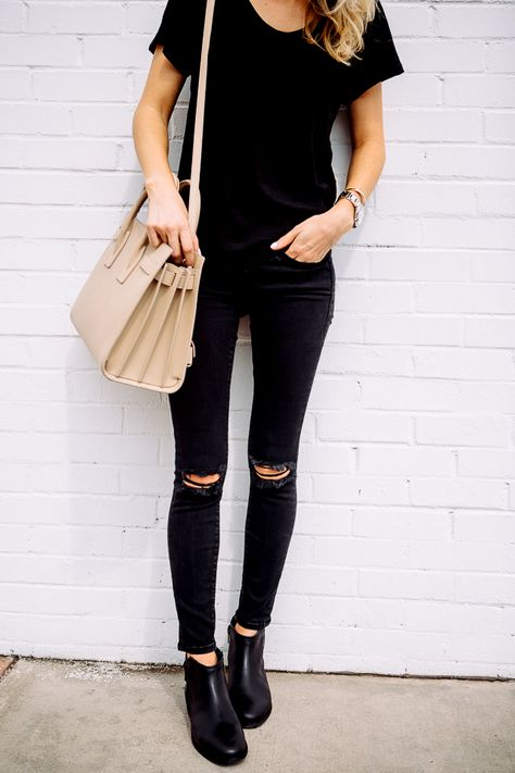 The caramel coat, grey turtleneck, and nike air max's can all be worn with simple ripped black jeans.
