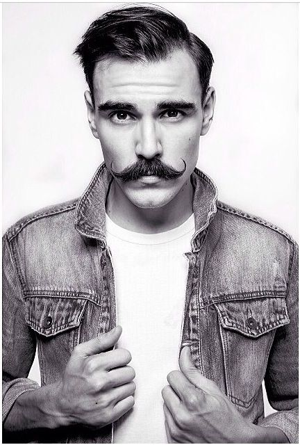 Curly Moustache: This image shows a different take on a regular moustache and I love the vintage curled style.