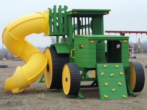 Systems Tractor Playscape with Tube Slide, Rockwall, Monkey bars and Trapeze.Tractor Playscape with Tube Slide, Rockwall, Monkey bars and Trapeze.