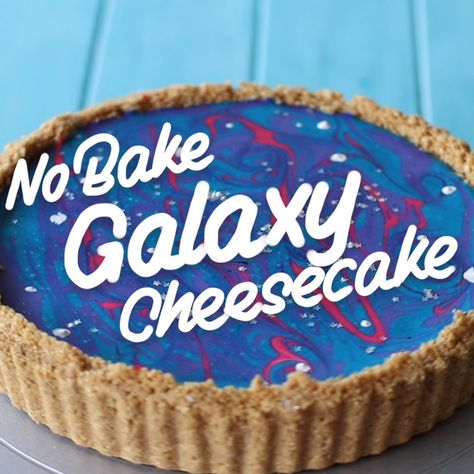 """Ever looked up at the night sky and thought """"I could eat that""""?  SERVINGS: 12  INGREDIENTS For the Crust  400g graham crackers  150g unsalted butters, melted  For the Cheesecake  300g marshmallows  175g unsalted butter, melted  500g Philadelphia cream cheese, softened  250ml thickened/whipping cream, warm  3 tbsp powdered gelatin + 3 tbsp water  5 drops purple food gel  3 drops pink food gel  3 drops blue food gel  Decorations  Silver star sprinkles"""