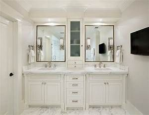 Double Vanity With Storage Tower Cabinet In The Middle And