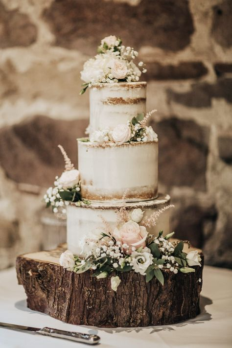 Semi-Naked Wedding Cake with Pink roses and foliage. Sitting on a rustic wooden log 3 Tier Wedding Cakes, Wedding Cake Roses, Themed Wedding Cakes, Wedding Cake Stands, Wedding Cake Rustic, Wedding Cakes With Cupcakes, Wedding Cakes With Flowers, Wedding Cake Designs, Wedding Cake Tables