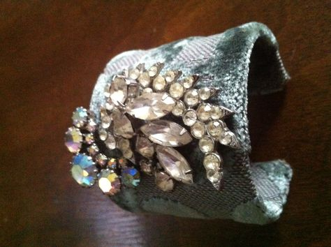 Cuff adorned with vintage pieces. $95