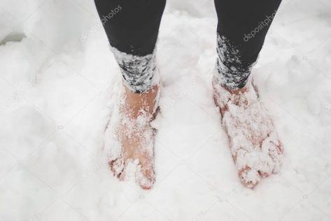 Men's bare feet in the snow - Stock Photo ,