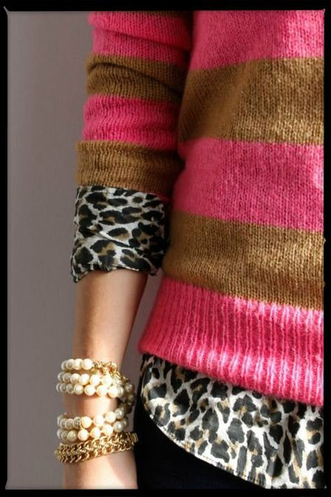 Leopard and stripes. I have this sweater and wear it with caramel based leopard print. :) I like that much better than this with the white base to the print.