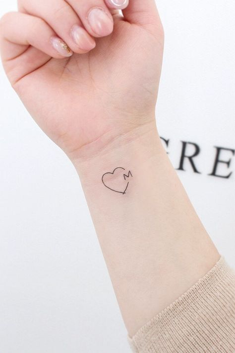 Heart With Letter Tattoo Design #hearttattoo ★ Small but meaningful wrist tattoos designs can be explored here. Pick a tiny rose flower or vital words, or some other cute feminine tattoo. #wristtattoo #wristtattoodesign #smalltattoo #tinytattoo #tattoodesign #tattooideas #glaminati #lifestyle