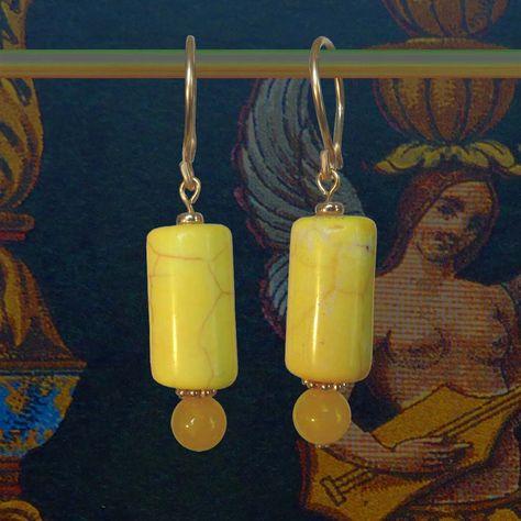 lange bungelende goud met gele oorbellen - geleen